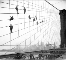 Brooklyn Bridge, showing painters on suspenders, October 7, 1914